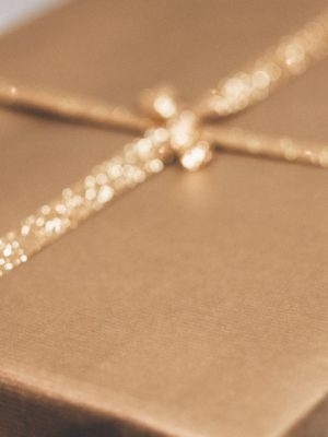 Gift wrapped in gold paper with a sparkly gold ribbon